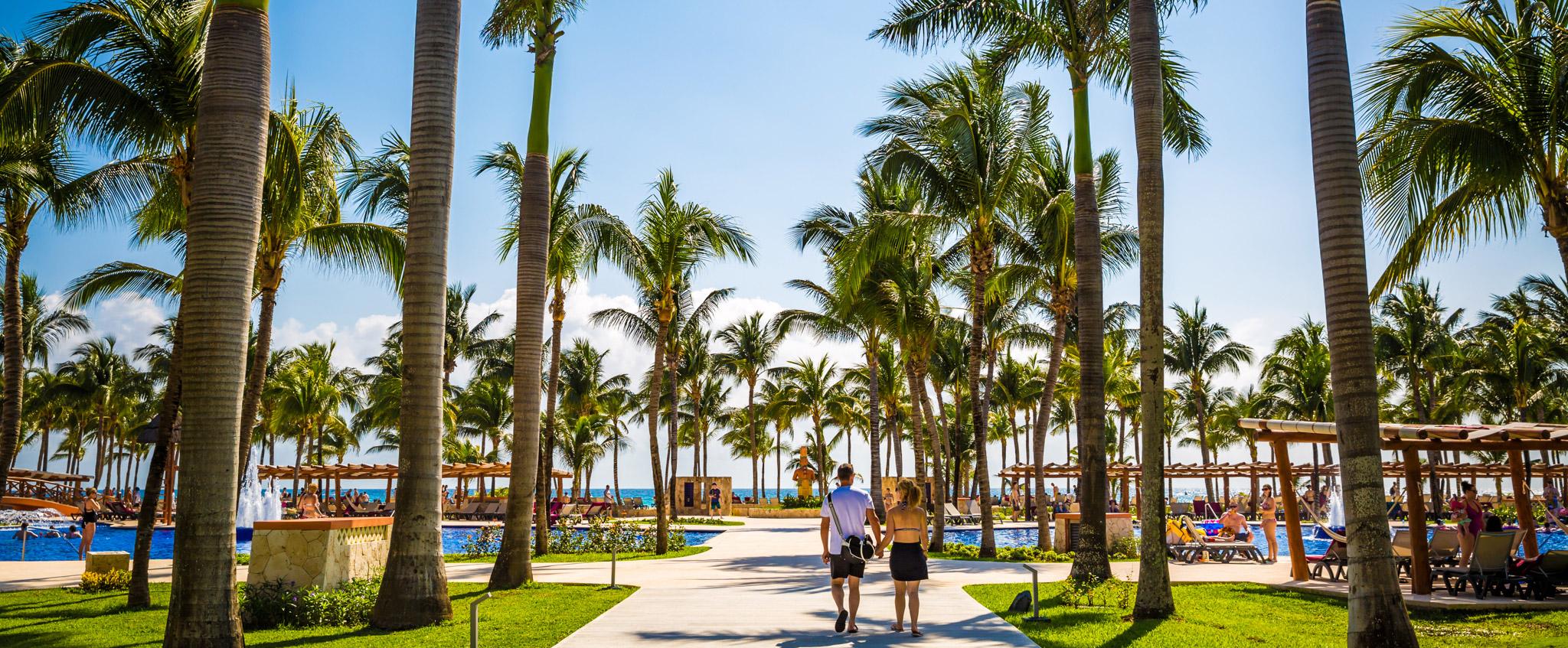 Couple walking towards pool at Barcelo Maya
