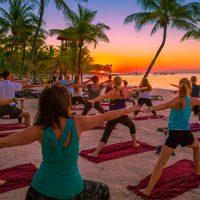 Sunrise group yoga activity on the beach