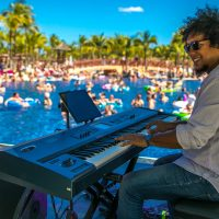 Aldo Lopez playing keyboard at the pool party