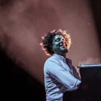 Aldo Lopez playing keyboard at the main stage