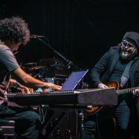 Carlos Varala playing guitar with Aldo Lopez on keyboard
