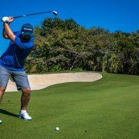 Man playing in golf tournament Mayakoba