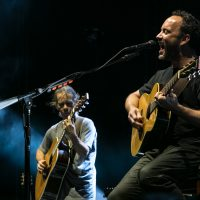 Dave Matthews playing guitar with Tim Reynolds on main stage
